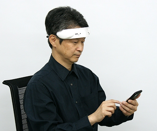 Distracted? Slap this Hitachi gizmo on your forehead to focus